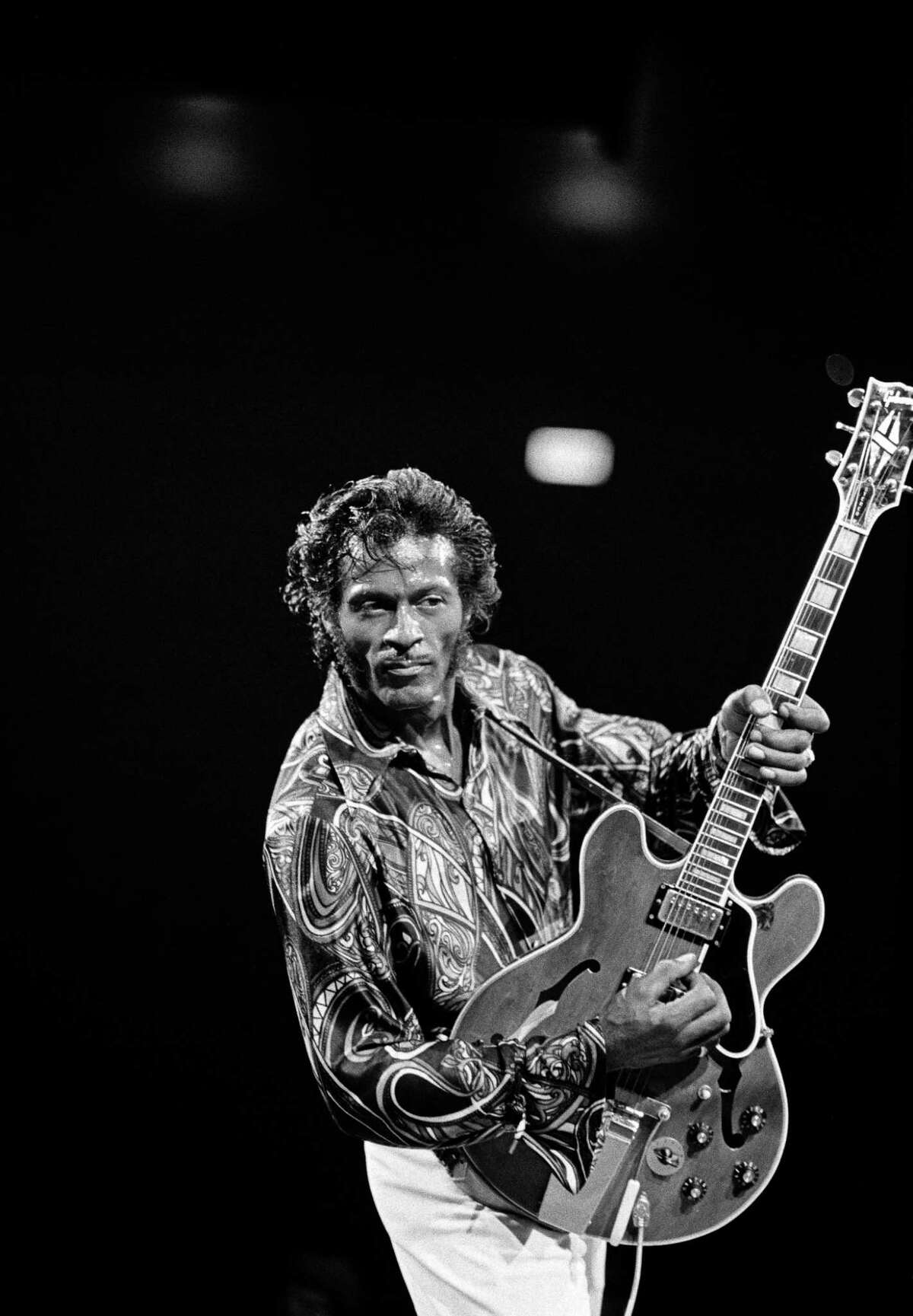 FILE -- Chuck Berry, who with his indelible guitar licks, brash self-confidence and memorable songs about cars, girls and wild dance parties did as much as anyone to define rock OnO rollOs potential and attitude in its early years, died on Saturday, March 18, 2017. He was 90. Berry in concert in New York in 1971. (Donal F. Holway/The New York Times) -- PART OF A COLLECTION OF STAND-ALONE PHOTOS FOR USE AS DESIRED IN YEAREND STORIES AND RECAPS OF 2017 -- ORG XMIT: NYT03