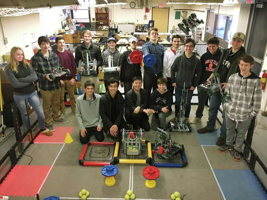 Ridgefield High School students have been designing robots as part of their Robotics I course. Back row, left to right: Annalisa Squitieri, William Despirito, Andrew Preston, Austin Stietzel, Matthew Gallagher, Christopher Hamilton, Nicholas Hall, Thomas daCruz, Liam Flaherty, Liam Sibley, Alexander Failla, and Colin Carvo. Front row, from left to right, are the class' competition winners: Ryan Crist, Aidan Flaherty, Matthew Wong, and Michael Kovacs Photo: Michael Murphy / Ridgefield Press Contributed