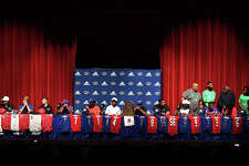 West Brook athletes on stage during the school's National Signing Day Event on Wednesday. Fifteen Bruins announced their intentions to attend twelve different universities in softball, basketball, baseball and football. Photo taken Wednesday, 2/6/19