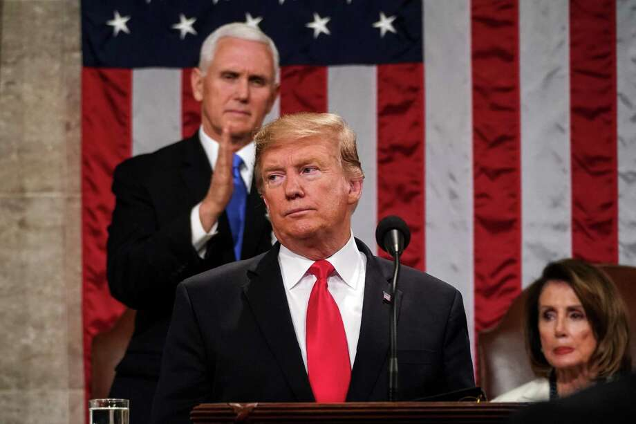"""(FILES) In this file photo taken on February 5, 2019 US President Donald Trump delivers the State of the Union address, alongside Vice President Mike Pence and Speaker of the House Nancy Pelosi, at the US Capitol in Washington, DC. - US President Donald Trump's call for an all-hands-on-deck push to end the AIDS epidemic focuses on trouble areas and vulnerable populations, as progress against HIV has stalled, officials said February 6, 2019. Although no dollar figure has been announced yet, details began to emerge on Wednesday of the plan touted by Trump in his State of the Union address a night earlier. """"My budget will ask Democrats and Republicans to make the needed commitment to eliminate the HIV epidemic in the United States within 10 years,"""" Trump said. """"Together, we will defeat AIDS in America and beyond."""" (Photo by Doug Mills / POOL / AFP)DOUG MILLS/AFP/Getty Images Photo: DOUG MILLS / AFP/Getty Images / AFP"""