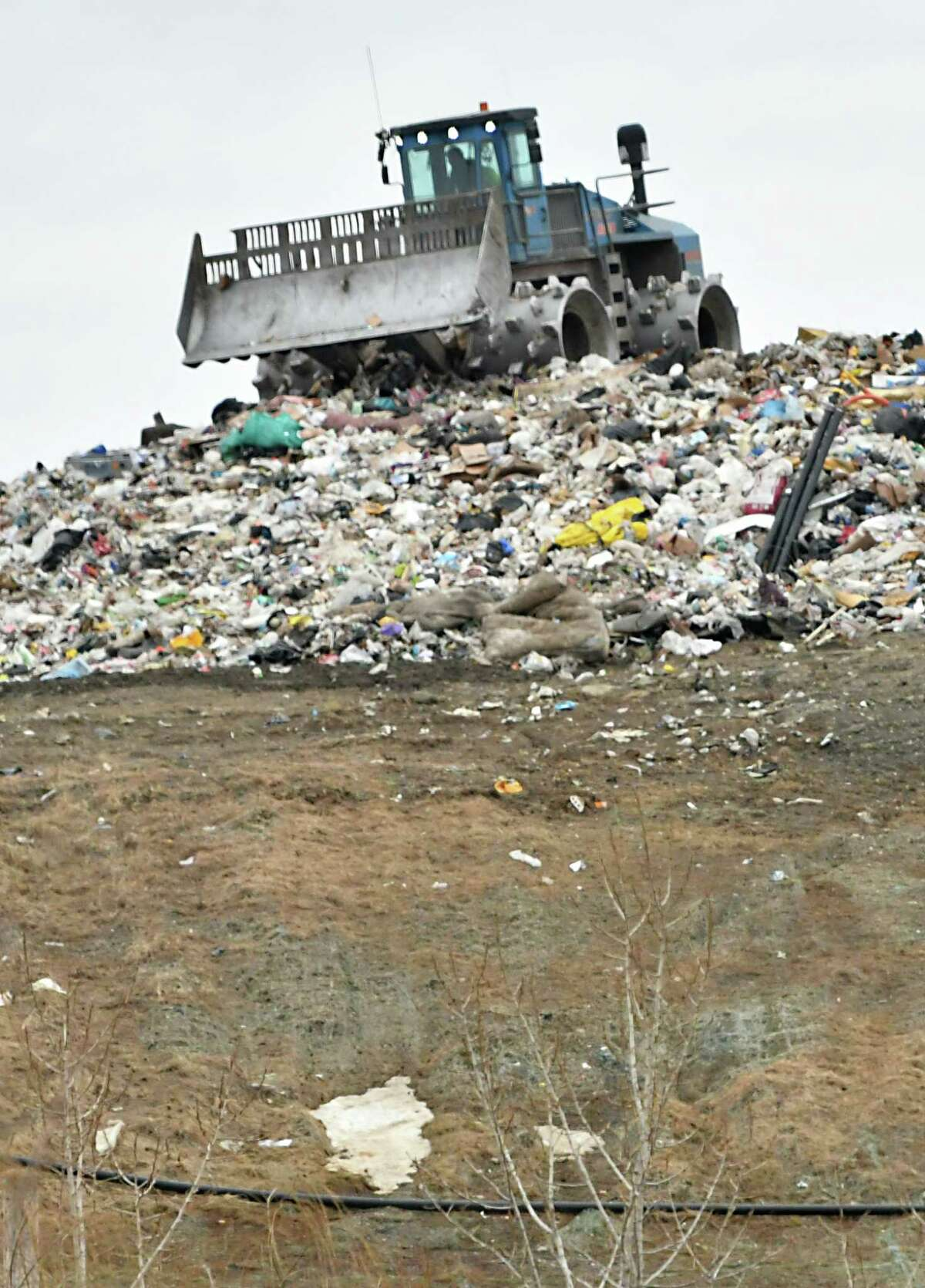 A tractor is seen moving garbage at the Colonie Landfill on Wednesday, Feb. 6, 2019 in Colonie, N.Y. (Lori Van Buren/Times Union)