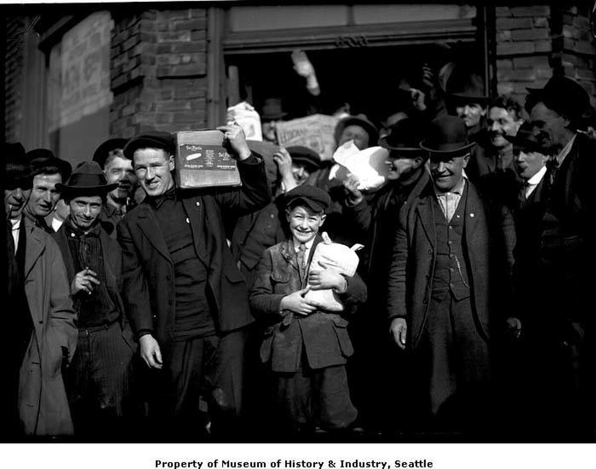 """""""During the Seattle General Strike in 1919, union members refused to report to their jobs. Businesses and stores were closed, and streetcars didn't run. Union members met the city's basic and emergency needs, however. They set up food lines, delivered milk to babies, and brought drugs to hospitals. They also maintained the city's electrical power and kept ambulances running."""" -MOHAI. Courtesy MOHAI, PEMCO Webster and Stevens Collection, image number 1983.10.10698.2."""