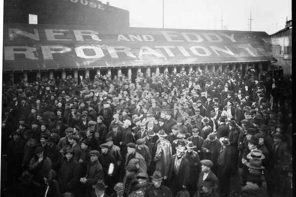 """The Seattle General Strike was a work stoppage by more than 65,000 workers in Seattle from February 6-11, 1919. The strike began in shipyards when workers were refused pay increases after two years of World War I wage controls. Most of the city's 110 local unions, including members of the American Federation of Labor (AFL) and the Industrial Workers of the World (IWW), joined the walkout in solidarity with the shipyard workers. Although the strike was non-violent and union members continued to meet the city's basic and emergency needs, government officials, the press, and much of the public viewed the strike as a radical attempt to subvert U. S. institutions. This image of workers was taken at the Skinner & Eddy Corporation shipyard located between Dearborn Street and Connecticut Street (now Royal Brougham Way). Skinner & Eddy employed about 13,500 people and is notable for completing more ships for the U.S. war effort during World War I than any other American shipyard."" -MOHAI. Photo courtesy MOHAI, PEMCO Webster and Stevens Collection, image number 1983.10.1347.3."