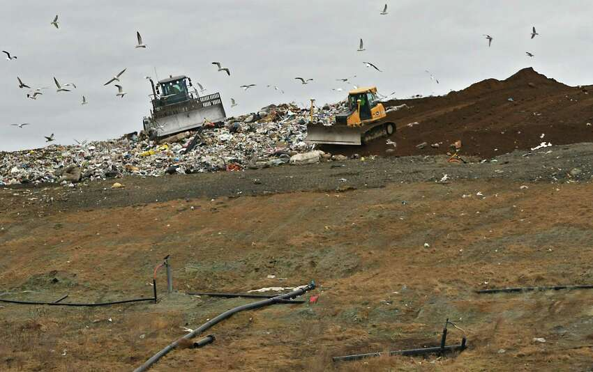 A tractor is seen moving garbage while another tractor covers the trash with soil at the Colonie Landfill on Wednesday, Feb. 6, 2019 in Colonie, N.Y. (Lori Van Buren/Times Union)