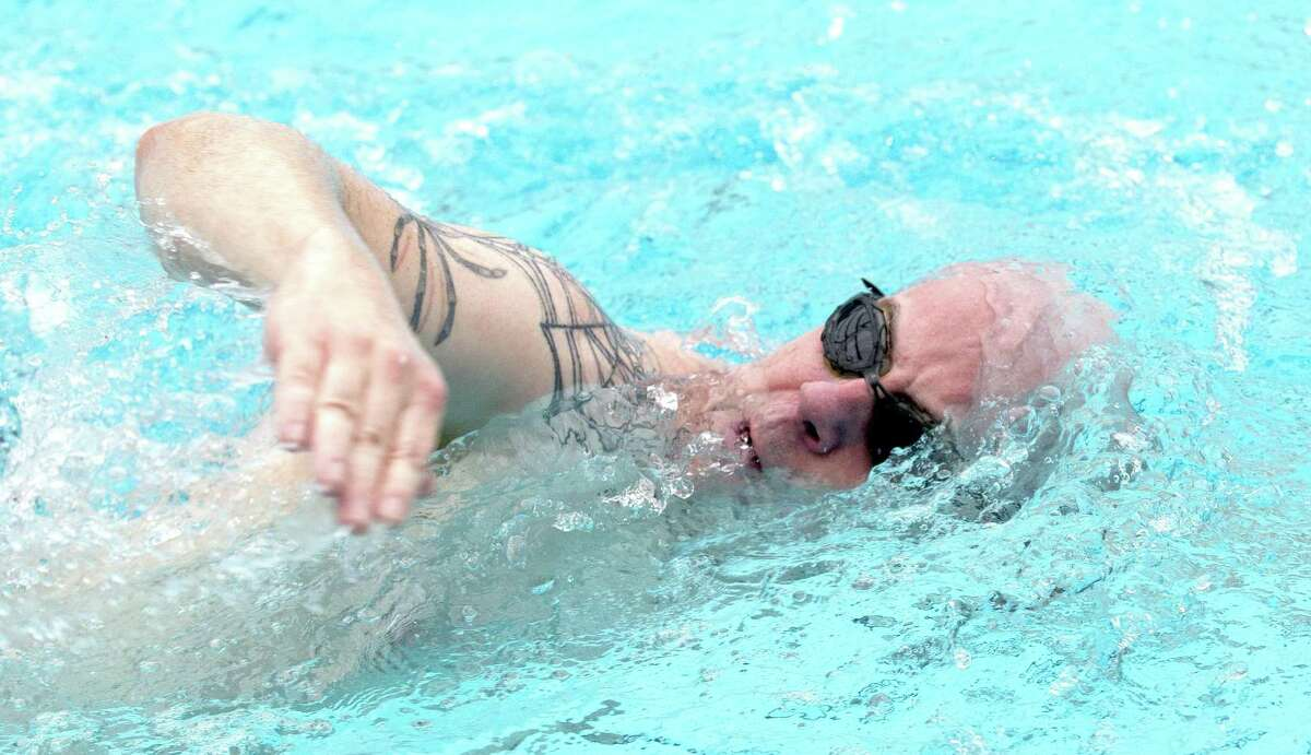 John Anthony Brown works on his freestyle form as he trains for the swimming portion of the upcoming Ironman competition at Shadowbend YMCA, Wednesday, Jan 30, 2019, in The Woodlands. Brown decided to participate in the 2019 event after volunteering at the 2017 competition.