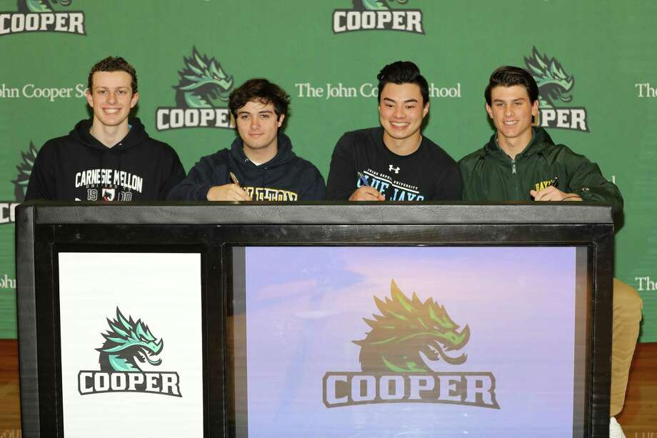 William Staebel (Carnegie Mellon), Braden Sebesta (Carleton College), Jonathan Spangler (Johns Hopkins) and Evan Godwin (Baylor) celebrated National Signing Day at The John Cooper School. Photo: Lynn Boeding / John Cooper School