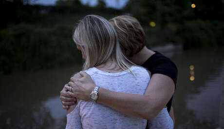 Janis hugs her daughter, Nicole. Nicole counts herself among Chad Foster's victims and testified at his sentencing in Harris County.