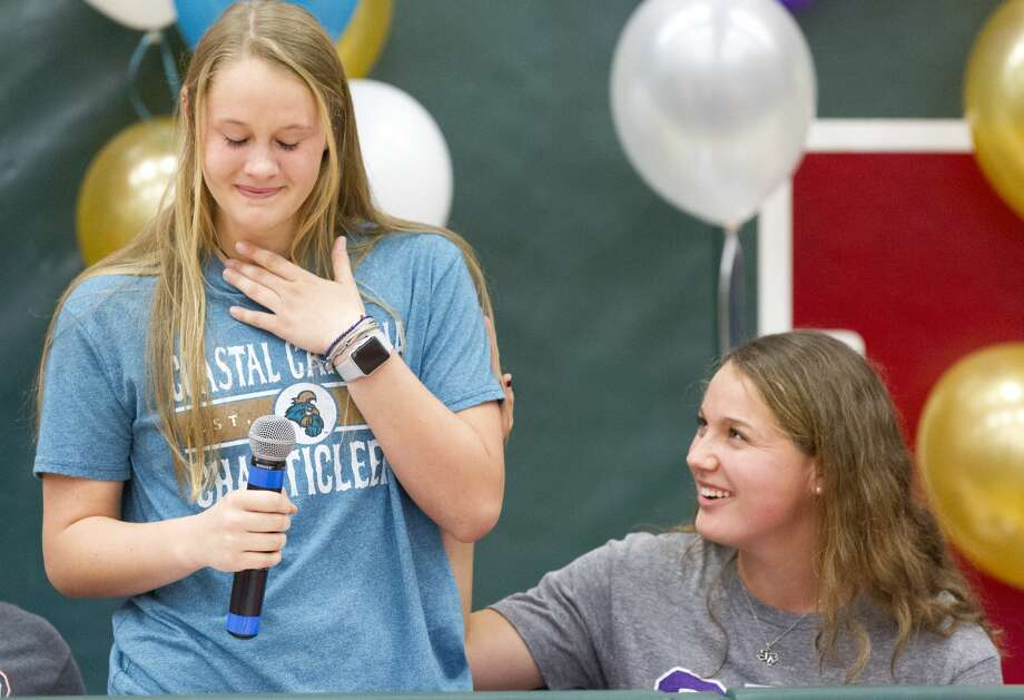 Ky Hudson reacts as she tears up while speaking beside Peyton Graves during a National Signing Day ceremony at The Woodlands High School, Wednesday, Feb 6, 2019, in The Woodlands. Hudson signed to play soccer for Coastal Carolina University, while Graves signed with Stephen F. Austin State University. Photo: Jason Fochtman/Staff Photographer