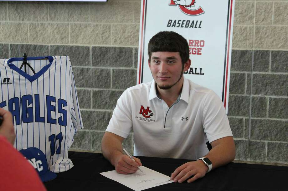 New Caney baseball player Samuel Martin poses for photos during the New Caney ISD National Signing Day ceremony on Wednesday at Texan Drive Stadium. Photo: Jon Poorman / Staff