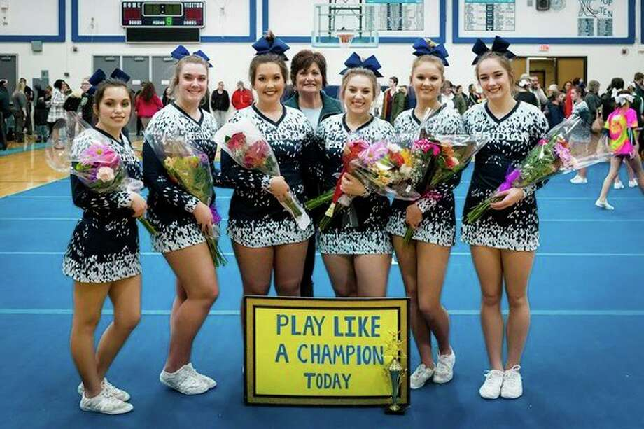 The six seniors on the Meridian cheer team were honored on senior night on Tuesday. Pictured, from left, are Liz Melchi, Aubrey Erskine, Becky O'Dell, head coach Val MacKenzie, McKenna Burns, Tana Spangler and Katie Blanchard.