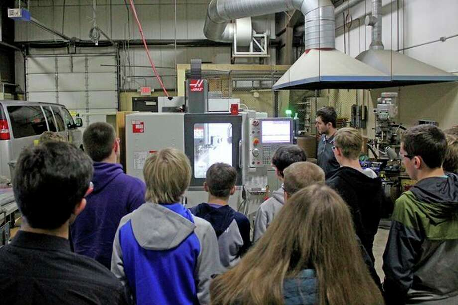 Huron County students are shown how some machinery works in the automotive technology wing of the Huron Area Technical Center. The tech center held its annual Career Day this week, in efforts to show students different programs they can join at the center. The event also featured many other businesses from around the area, including the Huron Daily Tribune. (Mike Gallagher/Huron Daily Tribune)