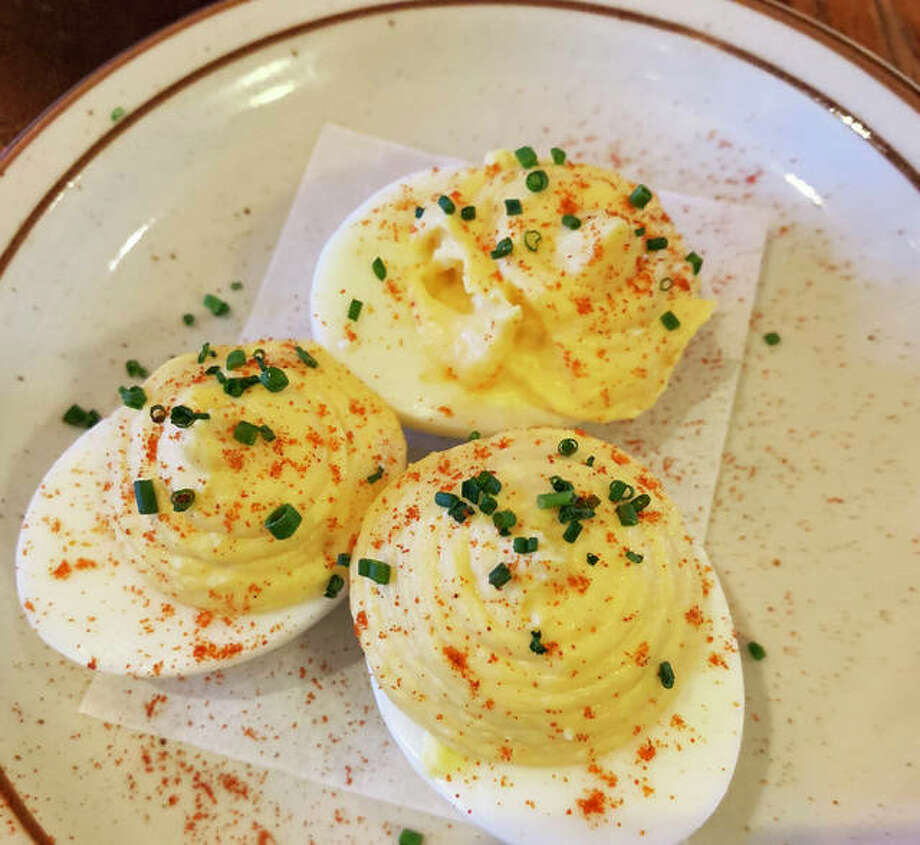 Deviled eggs with Frank's RedHot sauce, parmesan and paprika