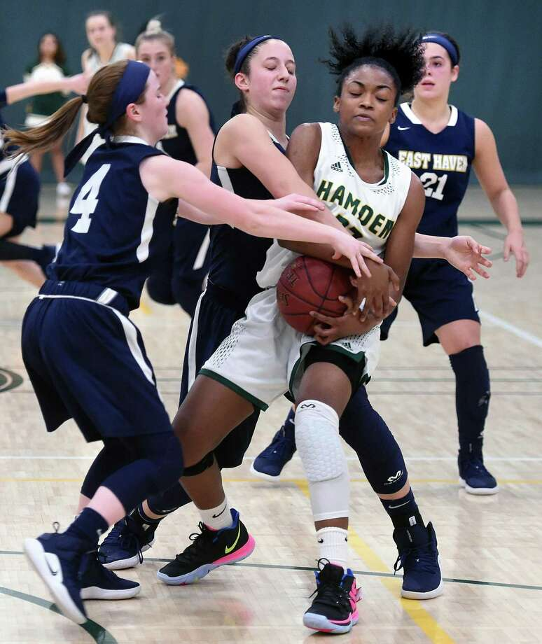 Taniyah Thompson of Hamden tries to hang onto the ball as East Haven presses late in the game at Hamden High School on February 5, 2019. Photo: Arnold Gold / Hearst Connecticut Media / New Haven Register