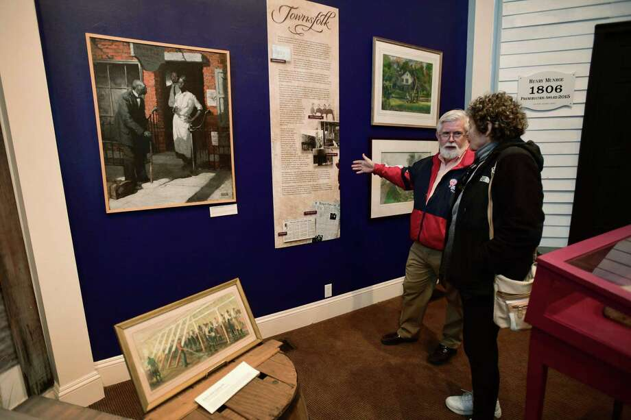 Westport resident Bill Armstrong and his wife Rindy Higgins look over the exhibit, Remembered: The History of African American's in Westport, Tuesday, February 5, 2019, at the Westport Historical Society in Westport, Conn. The Society is offering free admission to its award-winning exhibit during Black History Month. Exhibit Hours: Tuesday - Friday 11 - 6pm, Saturday: Noon to 5, closed Sunday and Monday. Photo: Erik Trautmann / Hearst Connecticut Media / Norwalk Hour