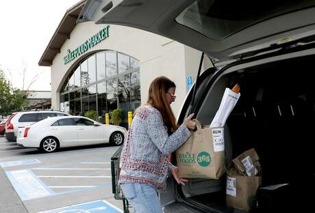 Debi LaBell of San Carlos, who does weekend work for Instacart on top of a full-time job, has organized with others online over the tips issue. Photo: Yalonda M. James / The Chronicle