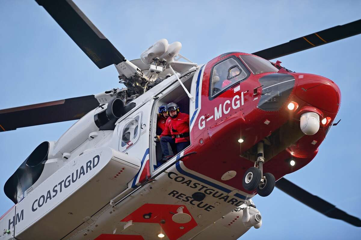 Rescuers in a Coast Guard helicopter rescued an elderly man after his distress signal was picked up by a company in Montgomery, Texas. (Photo by Jeff J Mitchell/Getty Images) >>>Closer to home, see dramatic rescues around the Houston area during Hurricane Harvey ...