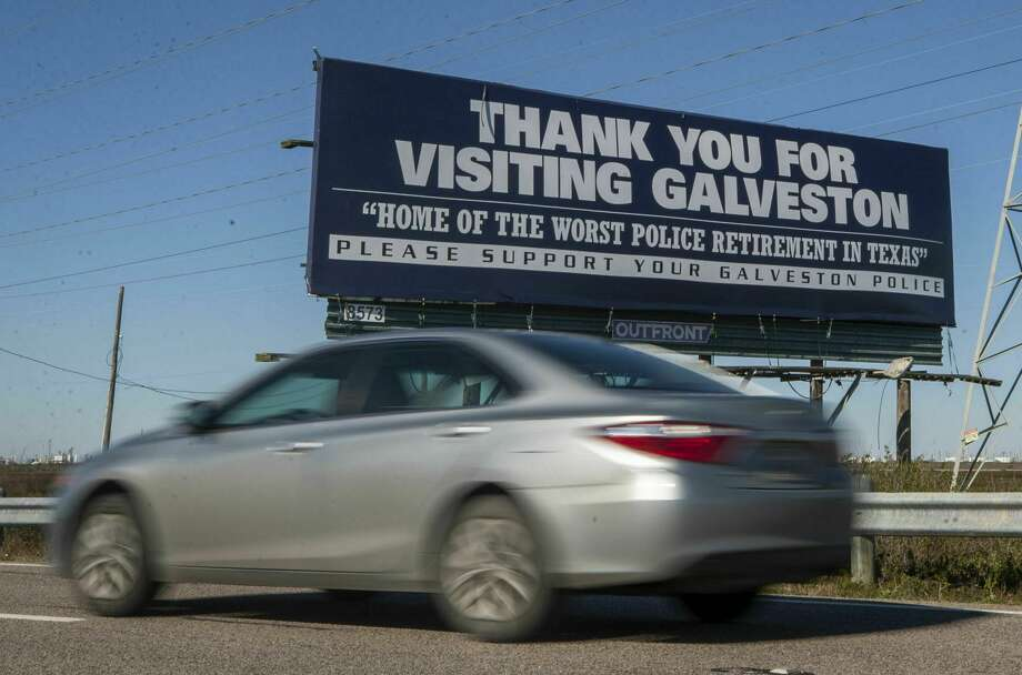 In this Tuesday, Jan. 29, 2019 file photo, a motorist drives past a billboard critical of Galveston's police pension plan on the northbound frontage road of Interstate 45 near Galveston, Texas. (Stuart Villanueva/The Galveston County Daily News via AP) Photo: Stuart Villanueva, MBR / Associated Press / © 2019 Stuart Villanueva/The Galveston County Daily News
