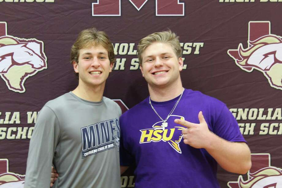 Magnolia West football players John Matocha, left, and Rusty Bertrand, pose for a photo following their signing ceremony on Wednesday. Photo: Jon Poorman / Staff