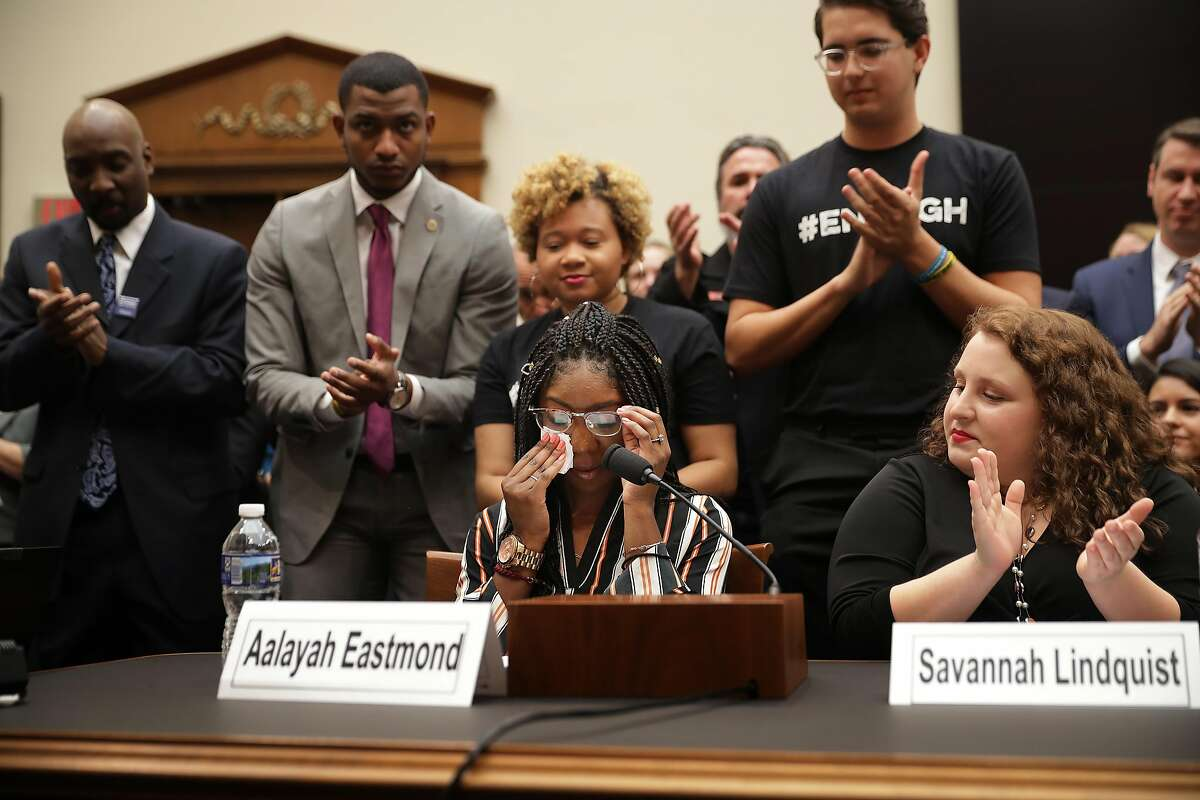 WASHINGTON, DC - FEBRUARY 06: Aalayah Eastmond (C), a survivor of the mass shooting at Marjory Stoneman Douglas High School in Parkland, Florida, wipes away tears as she receives a standing ovation while testifying to the House Judiciary Committee in the Rayburn House Office Building on Capitol Hill February 06, 2019 in Washington, DC. The committee heard testimony from gun violence victims, a trauma doctor, law enforcement officials and others during the first hearing in the House of Representatives on gun violence in eight years. (Photo by Chip Somodevilla/Getty Images)