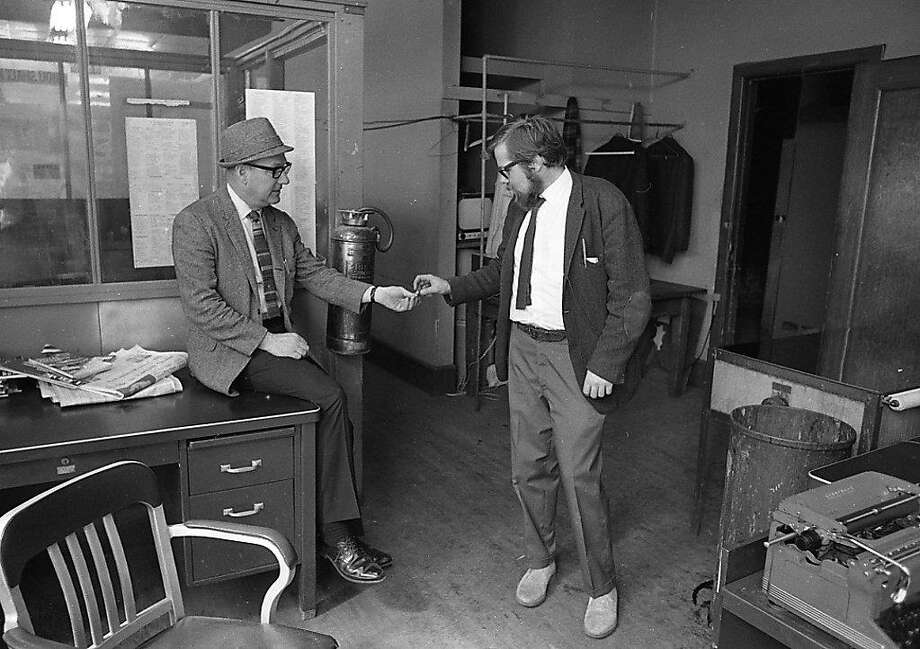 Photographer Art Frisch with Greg Peterson in the San Francisco Chronicle newsroom in 1969. Photo: Chronicle File / The Chronicle