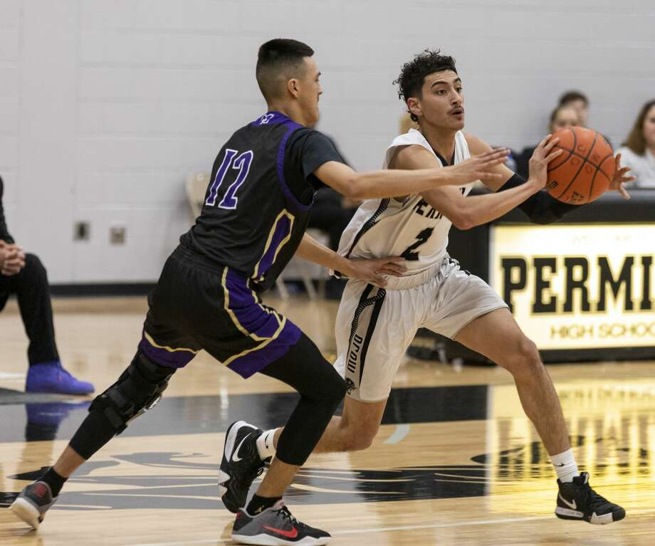 Permian's Jonathan Anaya (2) passes the ball while Midland High's Nicholas Terrazas (12) guards on Tuesday at Permian Field House. Photo: Jacy Lewis/191 News