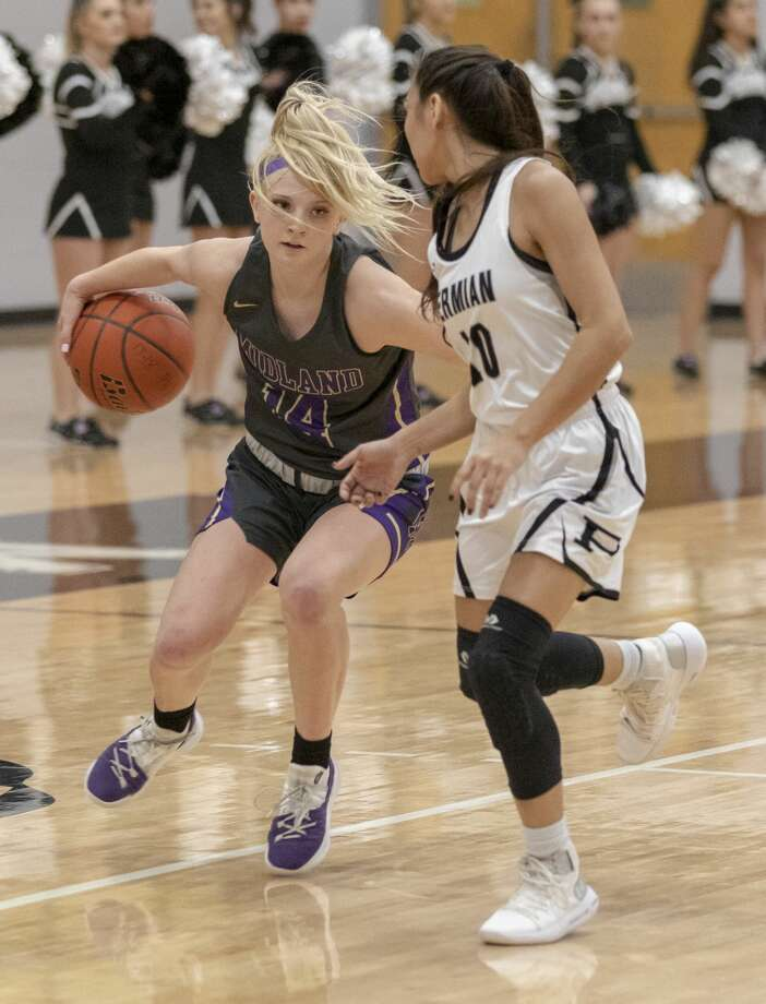Midland High's Taysha Rushton goes to dribble the ball behind her back on Tuesday at Permian Field House. Photo: Jacy Lewis/191 News