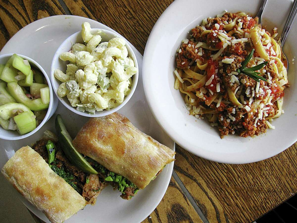 Braised pork and broccoli rabe sandwich with sides of macaroni salad and marinated cucumbers and fettuccine Bolognese from Carlucci's