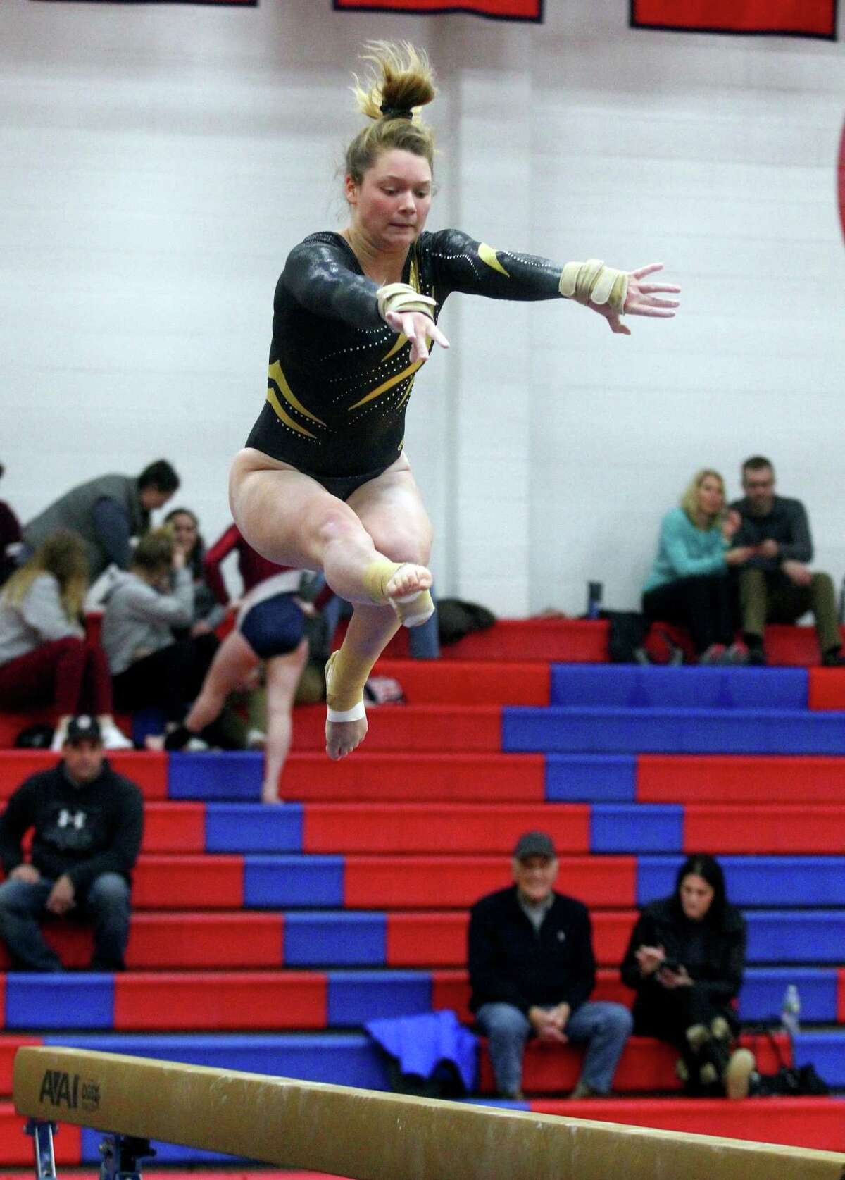 Hand's Grace Rogers competes on the balance beam against Foran in Milford on Jan. 17.