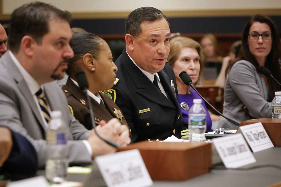 WASHINGTON, DC - FEBRUARY 06: (L-R) Director of Emergency General Surgery at Johns Hopkins Hospital in Baltimore Joseph Sakran, Baltimore City Sheriff's Office Domestic Violence Unit Commander Maj. Sabrina Tapp-Harper, Houston Police Chief Art Acevedo, George Mason University's Antonin Scalia Law School Professor Joyce Lee Malcolm and Giffords Law Center to Prevent Gun Violence Executive Director Robyn Thomas testify before the House Judiciary Committee in the Rayburn House Office Building on Capitol Hill February 06, 2019 in Washington, DC. During the hearing titled 'Preventing Gun Violence: A Call to Action,' the committee heard testimony from gun violence victims, a trauma doctor, law enforcement officials and other during the first hearing in the House of Representatives on gun violence in eight years. (Photo by Chip Somodevilla/Getty Images) Photo: Chip Somodevilla, Staff / Getty Images / 2019 Getty Images