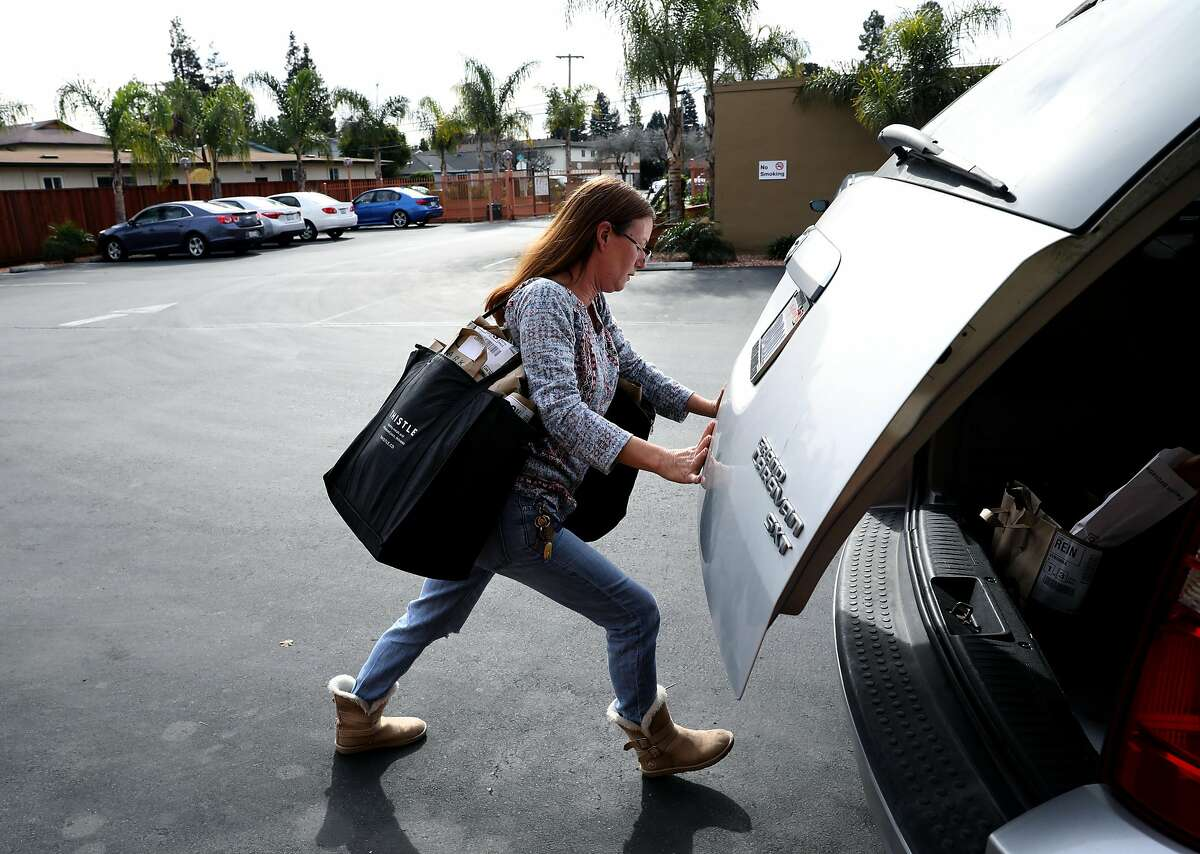 Debi LaBell, an independent contractor for grocery delivery service Instacart, arrives at a home to deliver an order to a customer in Redwood City, Calif., on Saturday, January 26, 2019. LaBell is upset about a way Instacart has changed payments which she says results in lower wages.