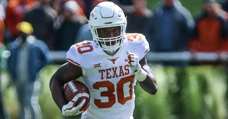 WACO, TX - OCTOBER 28: Texas Longhorns running back Toneil Carter (30) runs downfield for a first down during the game between the Baylor Bears and the Texas Longhorns on October 28, 2017 at McLane Stadium in Waco, Texas. Texas defeats Baylor 38-7. (Photo by Matthew Pearce/Icon Sportswire via Getty Images) Photo: Icon Sportswire/Icon Sportswire Via Getty Images / ©Icon Sportswire (A Division of XML Team Solutions) All Rights Reserved