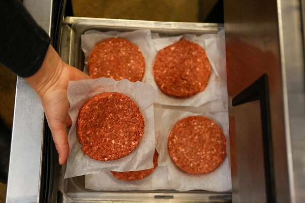Gott's Culinary director, Jennifer Rebman, pulls out an Impossible burger pattie to put on the grill at Gott's on Wednesday, February 6, 2019 in San Francisco, Calif.