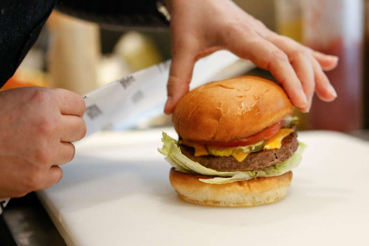 Gott's Culinary director, Jennifer Rebman, prepares an Impossible burger at Gott's on Wednesday, February 6, 2019 in San Francisco, Calif.