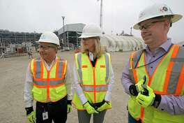 Cameron LNG CEO Farhad Aharbi, left, Lisa Glatch, Sempra Energy Strategic Initiative Officer, center, and Jamie Gray, Cameron LNG Project Director, right, talk at Cameron LNG Wednesday, Feb. 6, 2019, in Hackberry, LA. More than 8,000 people are working day and night to bring the liquefied natural gas plant's first production unit into operation over the next few months.