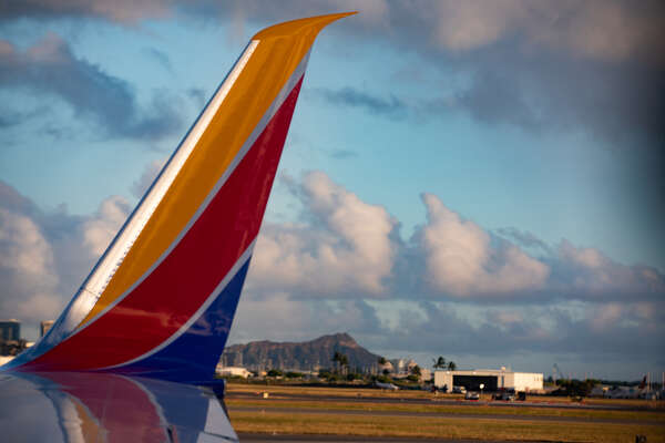 Southwest Airlines Boeing 737-800 winglet with Diamond Head in the background at Daniel K. Inouye International Airport.