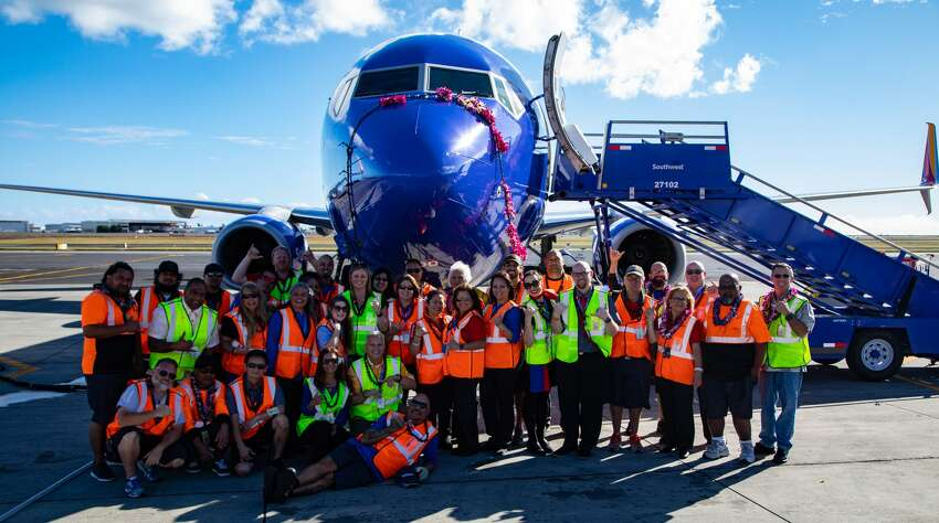 Southwest Airlines employees welcome the first Boeing 737-800 at Honolulu's Daniel K. Inouye International Airport on February 5, 2019
