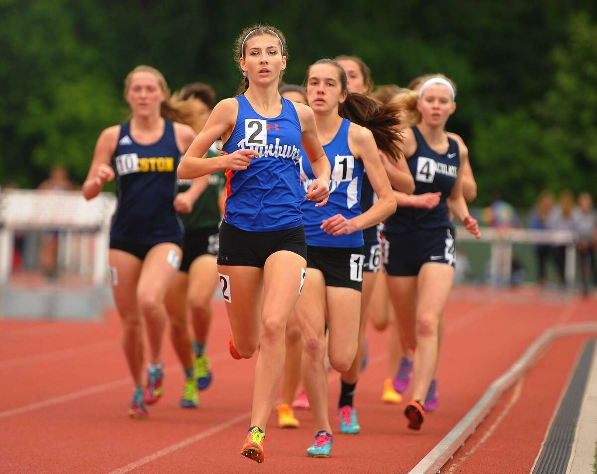 Danbury's Lauren Moore leads the girls 1600 meters at the CIAC Track & Field Championships in New Britain, Conn. on Monday, June 4, 2018.