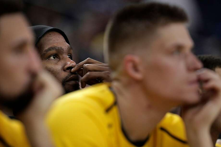 Kevin Durant (35) watches from the bench in the second half as the Golden State Warriors play the Toronto Raptors at Oracle Arena in Oakland, Calif., on Wednesday, December 12, 2018. Photo: Carlos Avila Gonzalez / The Chronicle