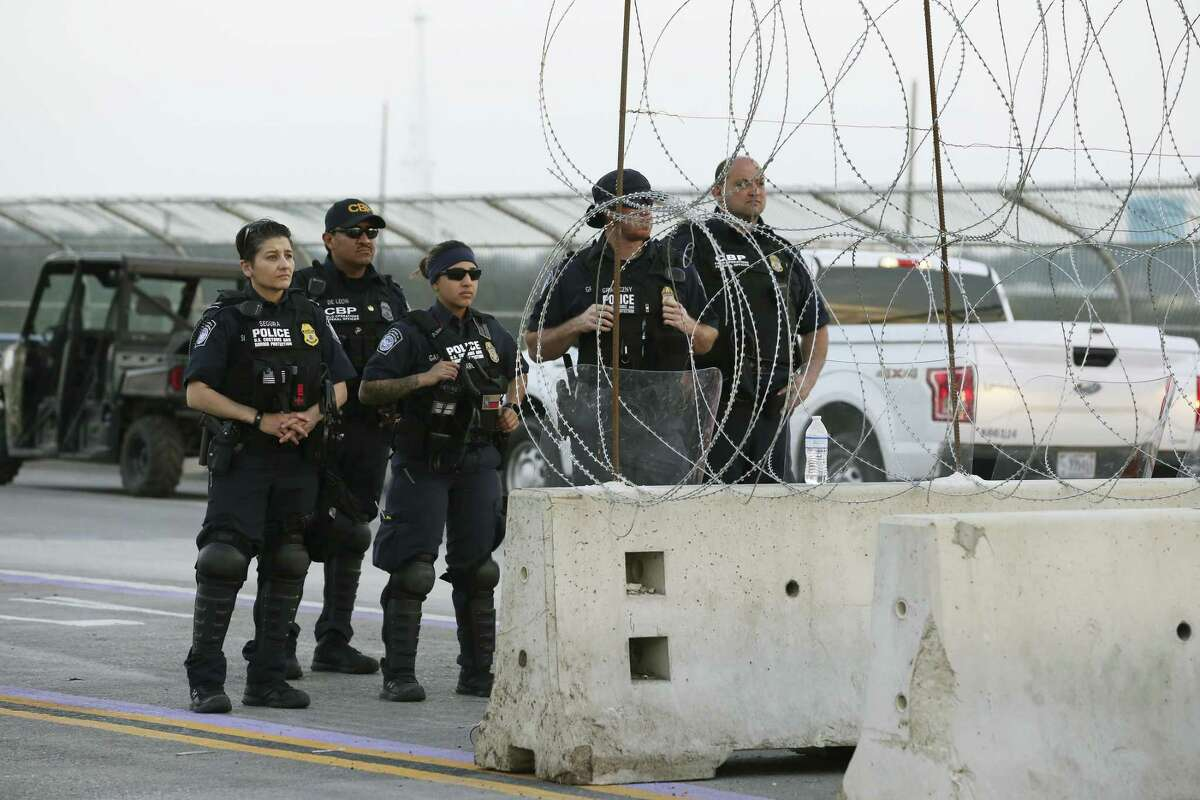 U.S. Customs and Border Protection officers keep watch at the midway point on the Texas International Bridge II in Eagle Pass on Wednesday.