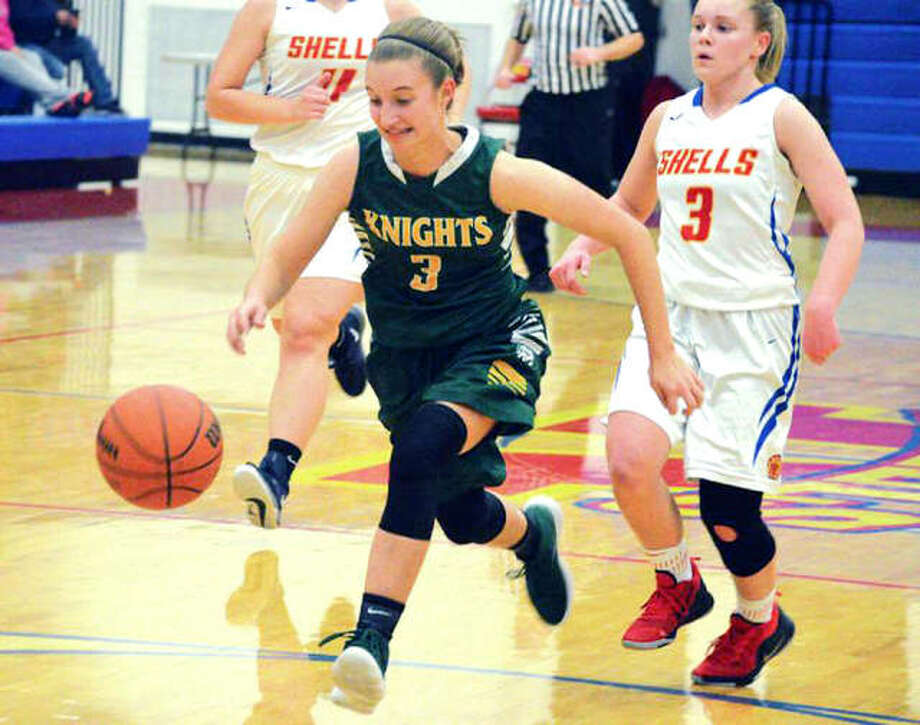 In a file photo, Metro-East Lutheran senior Sami Kasting, left, chases down the basketball during a game against Roxana earlier this season. Kasting and the Knights ended their season Wednesday with a loss to Okawville. Photo: Matt Kamp/Intelligencer