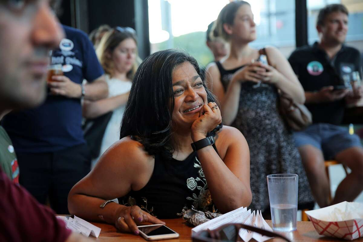 U.S. Rep. Pramila Jayapal listens as her campaign volunteers speak during a primary night event at Optimism Brewing for U.S. Rep. Pramila Jayapal in the 7th congressional district race, Tuesday, Aug. 7, 2018. (Genna Martin, seattlepi.com)