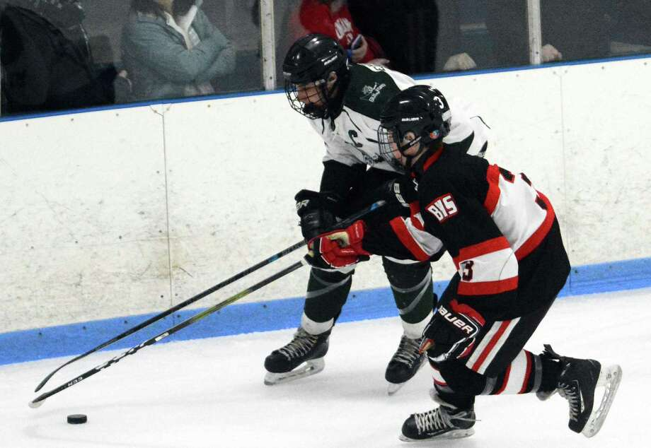 Branford's William Linder and Guilford's EJ Vickerman fight for the puck during a boys hockey game on Wednesday, Feb. 6, 2019 at Patsy DiLungo Rink in East Haven. Branford won 5-0. Photo: Dave Phillips / For Hearst Connecticut Media / For Hearst Connecticut Media / Stamford Advocate Freelance