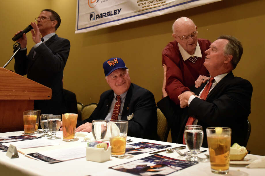 At right, Ken Marks, Midland Rockhounds chaplain, shakes hands with Frank Tanana, former Major League Baseball pitcher, during the West Texas Sports Banquet featuring Tanana as guest speaker, as well as Nate Newton, former Dallas Cowboys linebacker, Feb. 6, 2019, at Midland Country Club. Also pictured second from left, Miles Prentice, Rockhounds owner, and far left, Bob Hards, Rockhounds announcer. James Durbin/Reporter-Telegram Photo: James Durbin / ? 2019 Midland Reporter-Telegram. All Rights Reserved.