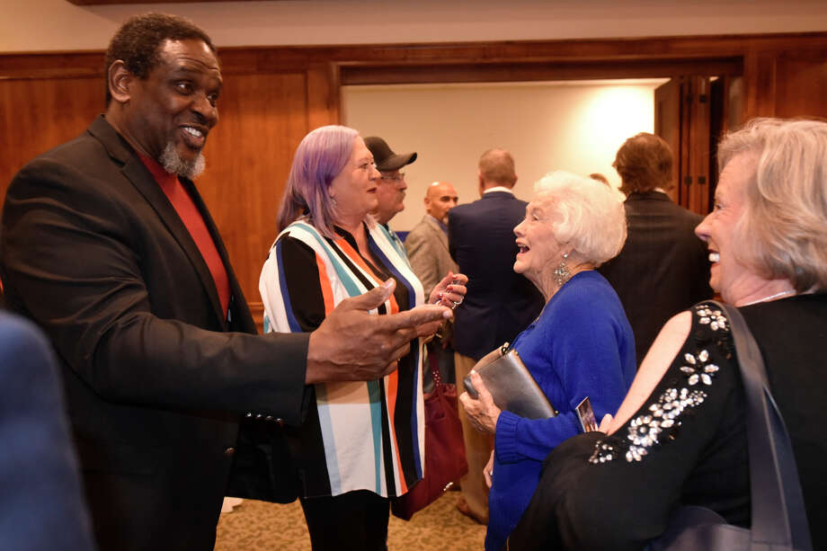 Nate Newton, former Dallas Cowboys linebacker, shares a laugh with Evelyn Stewart (wearing blue) and her daughter Nancy Davis (wearing black) during the West Texas Sports Banquet featuring Newton as well as guest speaker Frank Tanana, former Major League Baseball pitcher, Feb. 6, 2019, at Midland Country Club. Later in the program Evelyn Netwon was named Rockhounds fan of the year. James Durbin/Reporter-Telegram Photo: James Durbin / ? 2019 Midland Reporter-Telegram. All Rights Reserved.