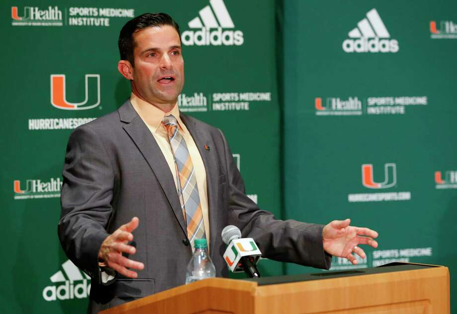 FILE - In this Wednesday, Jan. 2, 2019 file photo, Manny Diaz speaks during a news conference after being named Miami's new NCAA college football head coach in Coral Gables, Fla. Florida State and Miami were hoping signing day could help put to the negativity of 2018 to rest and provide a push toward better times. Miami, coming off a 7-6 season and coach Mark Richt's surprising retirement, managed to finally provide some good news for Hurricanes fans. New coach Manny Diaz bolstered the 'Canes recruiting class with some high-profile transfers. (AP Photo/Wilfredo Lee, File) Photo: Wilfredo Lee / Copyright 2019 The Associated Press. All rights reserved.