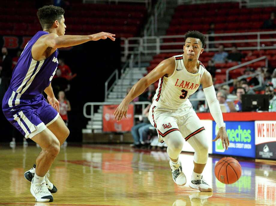Lamar's Nick Garth looks to get around Abilene Christian University's Payten Ricks during the second half of the game against Abilene Christian in the Montagne Center on Wednesday night.