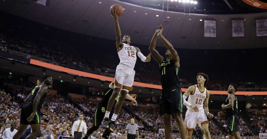 Texas guard Kerwin Roach II (12) drives to the basket past Baylor guard Mark Vital (11) during the second half on an NCAA college basketball game Wednesday, Feb. 6, 2019, in Austin, Texas. (AP Photo/Eric Gay) Photo: Eric Gay/Associated Press