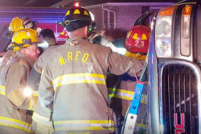 Wood River firefighters life a woman trapped in an SUV, strapped to a backboard, from the wreckage Wednesday evening.