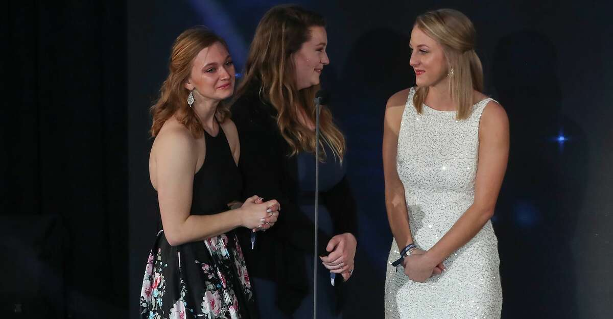 Annabelle O'Day (l-r), Kaitlyn Richards and Madison McCaskill students from Santa Fe High School were shocked that Sportsmanship Award recipient J.J. Watt gave his trophy to them during the Houston Sports Awards Wednesday, Feb. 6, 2019, in Houston.