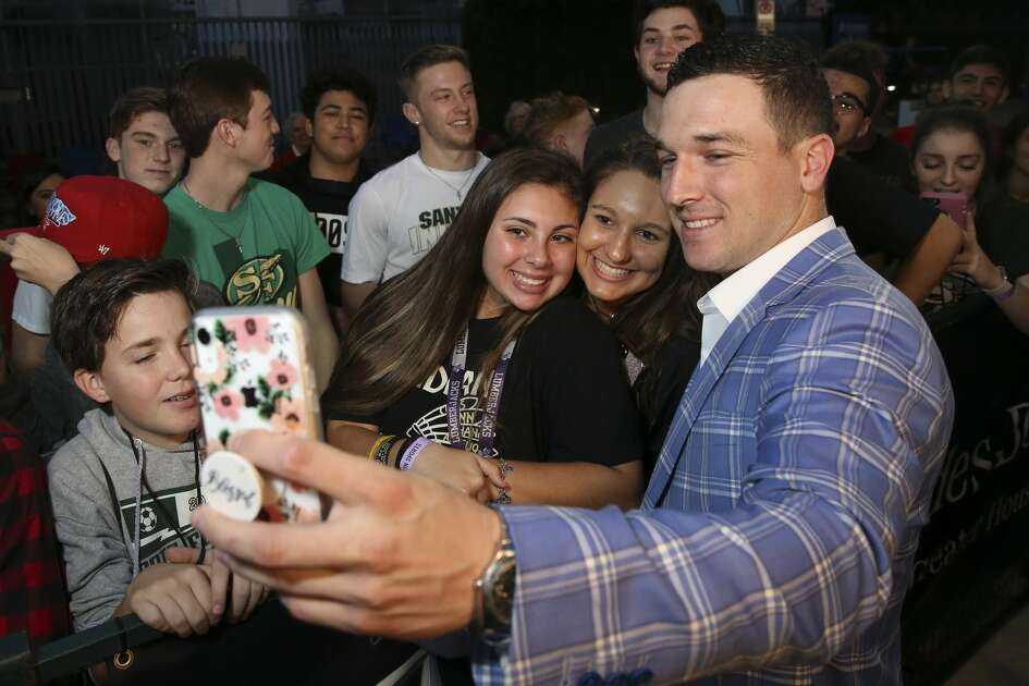Houston Astros third baseman Alex Bregman takes selfies with Santa Fe High School students on the Houston Sports Awards blue carpet on Wednesday, Feb. 6, 2019, in Houston.